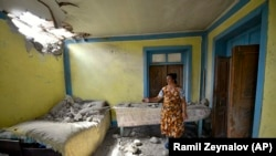 Azerbaijan -- A local woman shows damage in her house after shelling by Armenian forces in the Tovuz region, July 14, 2020