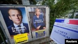 Plakati sa likom Emanuela Makrona i Marin Le Pen na ulicama Pariza