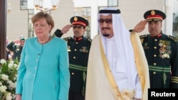 Saudi Arabia's King Salman bin Abdulaziz al-Saud (right) stands next to German Chancellor Angela Merkel during a reception in Jeddah in April.
