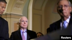 U.S. Senator John McCain called for a single, select committee comprised of both House and Senate members, something Senate Majority Leader Mitch McConnell (riht) opposes.