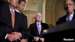U.S. Senate Republican leaders, including John McCain (center) and Senate Majority Leader Mitch McConnell (right)