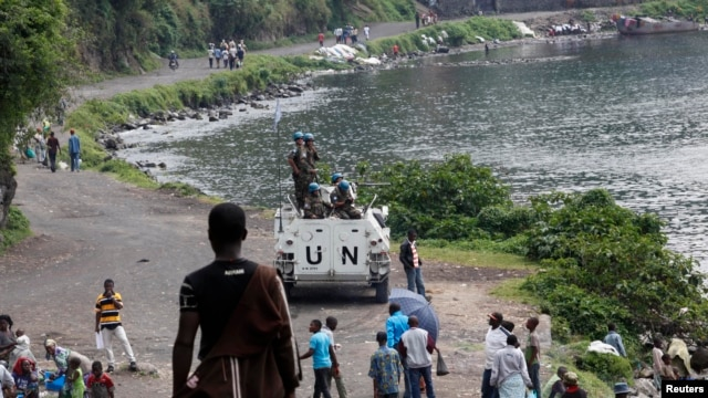 United Nations peacekeepers stand on top of their armored vehicle as they patrol near Lake Kivu in the Democratic Republic of Congo. (file photo)