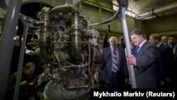 Ukrainian President Petro Poroshenko (front right) on a visit to the Yuzhmash missile factory in 2014.