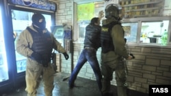 Poliția rusă într-o acțiune împotriva imigranților ilegali în decembrie 2013