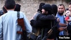 Казахстанские джихадисты на видео из Сирии. Скриншот с сайта Youtube.