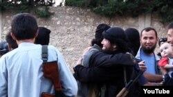 Сирияга согушка барган казакстандыктар. (Youtube сайтынан алынган бул сүрөт качан тартылганы белгисиз).