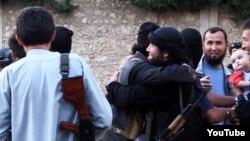 """Сирияға аттанған """"Қазақстандық жиһадшылар"""". Ютуб сайтынан алынған скриншот."""