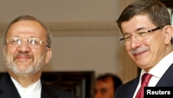 Министры иностранных дел Ирана (слева) и Турции (архивное фото)