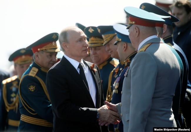 Putin welcomes guests during the Victory Day parade.