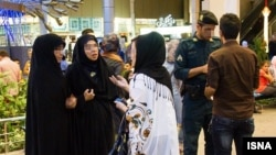Iran enforces a dress code that requires women to cover their hair with the Islamic head scarf, or hijab, and enforces the measure through periodic crackdowns.