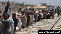 FILE: Afghan refugees wait for registration with Pakistani authorities in Quetta, Balochistan in August 2017.