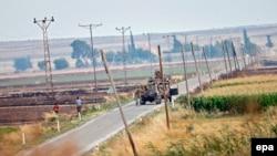 Сириямен шекара маңында жүрген Түркия әскерилері. 24 шілде 2015 жыл.