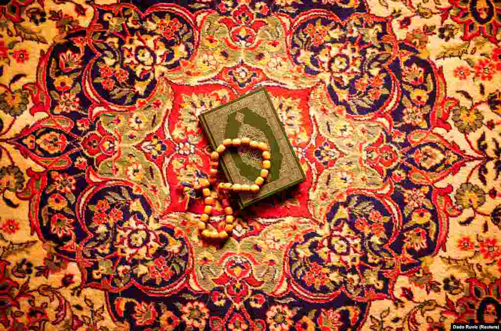 A copy of the Koran lies on the carpet at the Sulejmanija Mosque in Travnik.