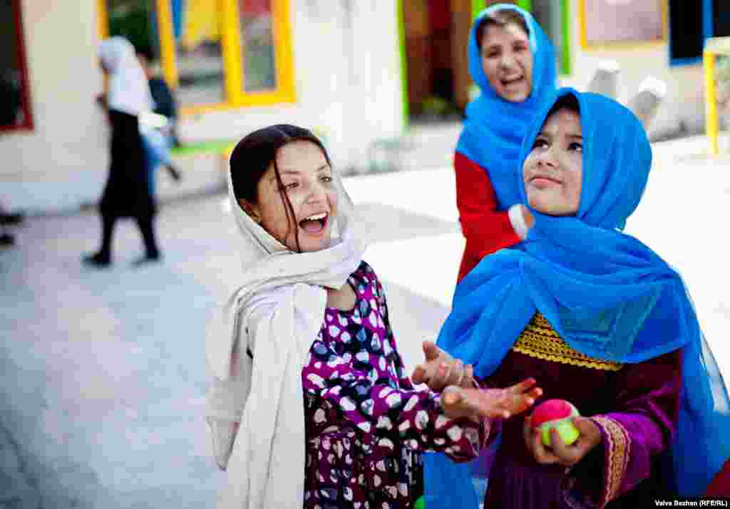 About 50 of the circus school's 200 students in Kabul are girls. Nadia (left) and Basgulah practice juggling.