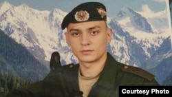 The Russian military says Ilya Gorbunov, 19, died when a tank he was driving rolled off a bridge. His sister says that a soldier from her brother's unit said Ilya died after being locked in a tank and suffocating.