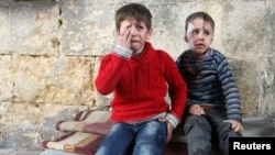 Injured boys at a field hospital after air strikes on the rebel held areas of Aleppo on November 18