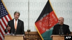 U.S. Secretary of State John Kerry (left) and Afghan President Ashraf Ghani take part in a press conference at Dilkusha Palace in Kabul on April 9.