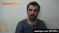 Armenia - A screenshot of a July 31 police video of the interrogation of Gevorg Melkonian, one of the gunmen that seized a police station in Yerevan.