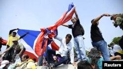 Таиландтағы үкіметке қарсы акцияға қатысушылар. (Көрнекі сурет)