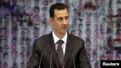 President Bashar al-Assad speaks at the Opera House in Damascus on January 6.