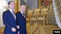 Russian President Dmitry Medvedev (left) and Prime Minister and President-elect Vladimir Putin walk after taking part in the State Council session at the Kremlin in Moscow on April 24.