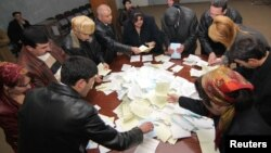 Tajik election workers counting ballots at a polling station in Dushanbe after votes were cast in a February 2010 election.