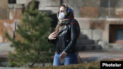 Armenia -- A woman wears a medical mask in Yerevan, March 1, 2020.