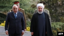 Iranian President Hassan Rouhani (right) receives Iraqi Prime Minister Adel Abdel Mahdi in Tehran on April 6.