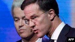 Baş nazir Mark Rutte (sağda) və ifrat sağçı Geert Wilders