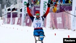 Russian Paralympian Roman Petushkov celebrates his gold medal in a biathlon at the 2014 Sochi Paralympic Games in March 2014.