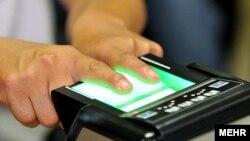 Iran -- a man tests Fingerprint Identification System .UNDATED