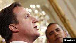 Лидеры США и Британии - Барак Обама (справа) и Дэвид Камерон