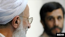 Ayatollah Mohammad Taqi Mesbah-Yazdi (left) meets with President Mahmud Ahmadinejad in Qom in 2007.