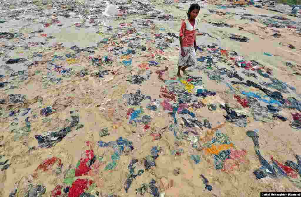 Discarded items of clothing lie strewn on the ground in a Rohingya refugee camp in Cox's Bazar, Bangladesh. (Reuters/Cathal McNaughton)