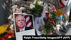 Flowers and personal items outside Senator John McCain's office in Phoenix as people pay their respects to the late Arizona senator.