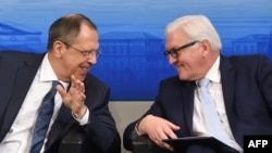 Russian Foreign Minister Sergei Lavrov (left) and German counterpart Frank-Walter Steinmeier laugh ahead of a panel discussion of the 52nd Munich Security Conference in Munich in February.
