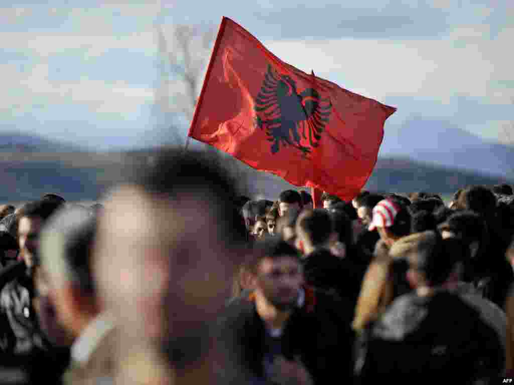 Ethnic Albanians wave an Albanian flag during an electoral rally in Mitrovica, in northern Kosovo. Photo by AFP