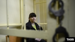 Jailed opposition activist Taisia Osipova behind bars in a courtroom in Smolensk in August 2012