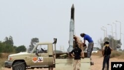 Forces loyal to Libya's UN-backed unity government prepare a missile launcher during clashes with Islamic State (IS) militants west of Sirte earlier this month. Libyan forces began the battle to retake the city from IS in May.
