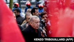 TURKEY - Turkish President Recep Tayyip Erdogan delivers a speech as he arrives for a meeting at Permanent Representation of Turkey to the European Union in Brussels on March 9, 2020