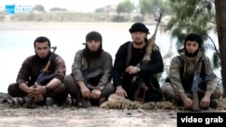 The defection to Islamic State of former Tajik special-forces commander Gulmorod Halimov (second from right) may be one of the reasons why so many of his compatriots have become suicide bombers for the extremist group. (file photo)