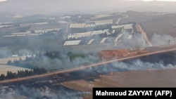File photo - This picture taken on September 1, 2019 from a location near the southern Lebanese village of Maroun al-Ras, close to the border with Israel, shows smoke rising from fires along the border with Israel on the Lebanese side.