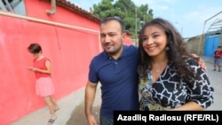 Azerbaijani journalist Seymur Hazi (left) after his release from Prison on August 29.