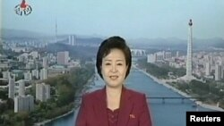 A news reader announces the launch of a working satellite to mark the 100th birthday of Kim Il Sung.