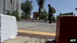 Blood stains are seen at the scene where a NATO soldier was stabbed to death in Kabul, August 20, 2014.