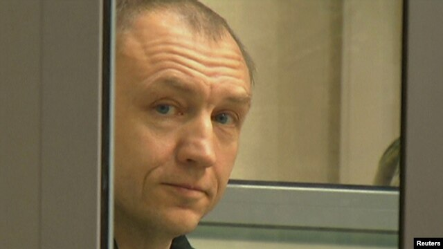 Eston Kohver is shown in a defendants' cage during a court hearing in Pskov, Russia, on June 2.
