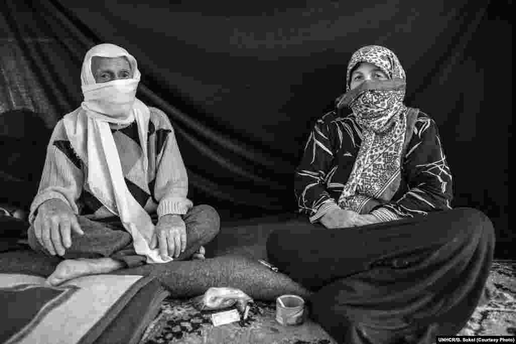 "Ayman, 82, and his wife Yasmine, 67, at the Nizip refugee camp in Turkey. They fled their home in a rural area near Aleppo after their 70-year-old neighbor and his son, a shepherd, were brutally killed. Breaking into tears, Ayman described how nearby farms came under attack and homes were looted and set on fire. ""It is unbelievable that any human being can do this to another,"" he said. Ayman says his wife is the most important thing he brought from home. ""She's the best woman I've met in my life,"" he says. ""Even if I were to go back 55 years, I would choose [her] again."""