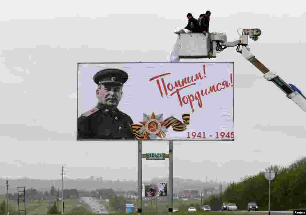 "Workers fix a banner showing an image of former Soviet dictator Joseph Stalin during preparations for Victory Day outside Stavropol, Russia. Russia will celebrate the 70th anniversary of the victory over Nazi Germany in World War II on May 9. The banner reads ""We remember! We are proud!"" Human rights activists in Russia have condemned the use of Stalin's image, saying he was personally responsible for the repression and deaths of millions of Soviet citizens. (Reuters/Eduard Korniyenko)"