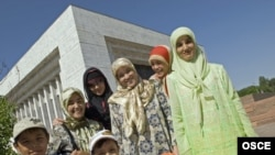 Kyrgyz women and children from the city of Osh on a visit to the capital, Bishkek.