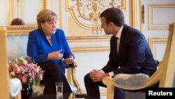 Ангела Меркель и Эммануэль Макрон.